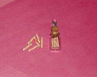 1 X Charm's mini vial and 25 mm candy sticks