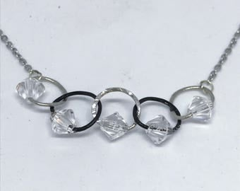 Delicate silver and black hammered wire circle choker