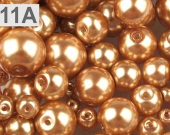 A 11-100 g of 4 to 12 mm glass pearl beads different sizes