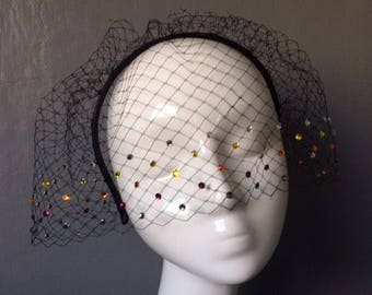 Handmade black birdcage veil with with multicoloured swarovski crystals on black leather headband - can be ordered in different colours