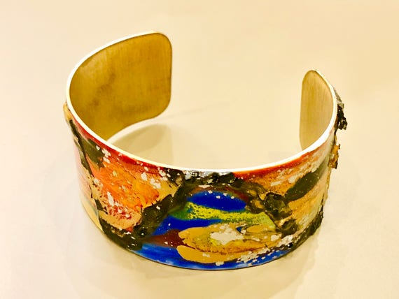 Enamel painted aluminum cuff open bracelet with abstract design (orange, blue, green, yellow, red, gold, black)