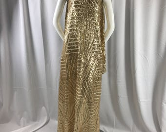 Shiny gold sequins-geometric design embroider on a ivory mesh-apparel-fashion-decorations-nightgown-sold by the yard.
