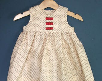 Gathered dress and bows for baby