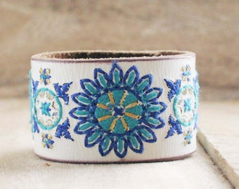 CUSTOM HANDSTAMPED white leather cuff with turquoise blue stitching by mothercuffer