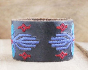 CUSTOM HANDSTAMPED black leather cuff with multi color stitching by mothercuffer