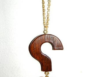 Necklace has heart take pine and sipo who