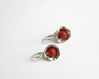 Earrings with red coral.
