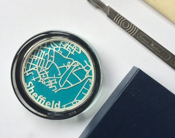 Handcut map of Sheffield protected in a glass paperweight