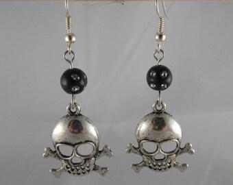 Boucles069 - Black head earrings skull