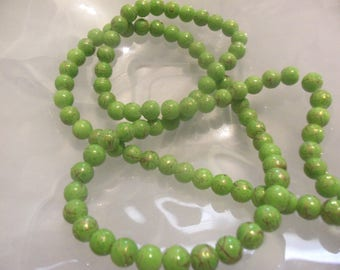 Green/Gold: Set of 10 glass drawbench beads, spray-painted, round, 8 mm