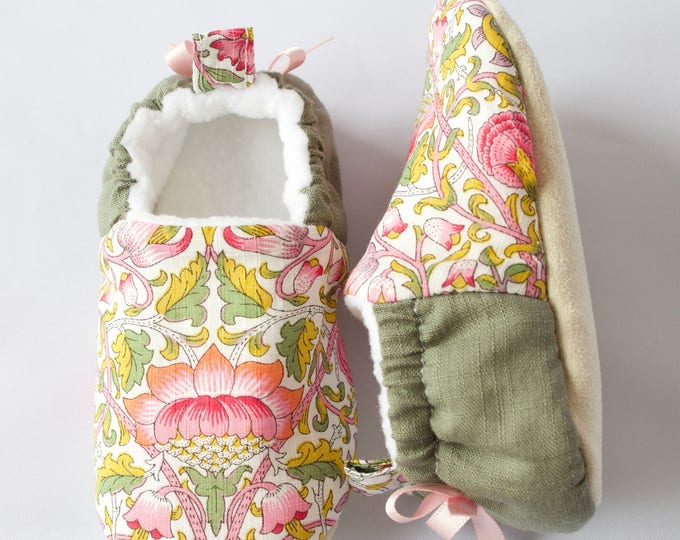 Soft floral baby girl mocs/ shoes with a green lined back and a dainty satin bow