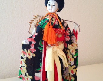Vintage Japanese Geisha Doll in Black Floral Kimono. Japanese Doll in Wisteria Dance Costume.Oriental Asian Doll Kimono, posed with Wisteria