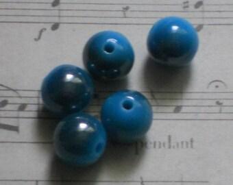 10 round blue and iridescent acrylic beads