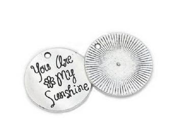 "Large round charm ""You re my sunshine"" in silvery metal 25 mm"