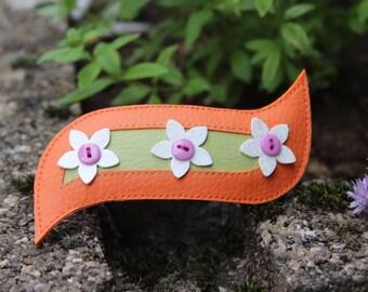 Orange, white, green and purple flower hair clip