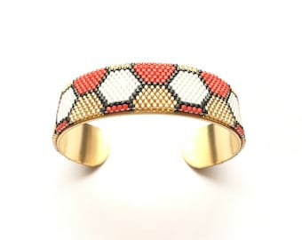 Very nice bracelet black and white, red and gold woven miyuki mounted on rigid bracelet
