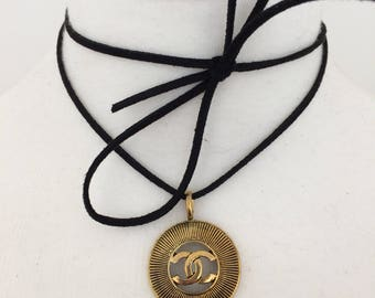 Chanel VIP Sunburst Pendant Necklace