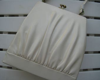 Gathered Off-White Faux Leather Handbag by Dover, USA.