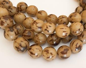 "Buri Nut Beads 10mm Round Tiger 16"" strand"