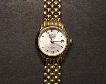 Vintage Bill Blass Watch Ladies Quartz Gold Toned Date and Time BS110 229 VJ22 Water Resistant 100 Feet Stainless Back Working