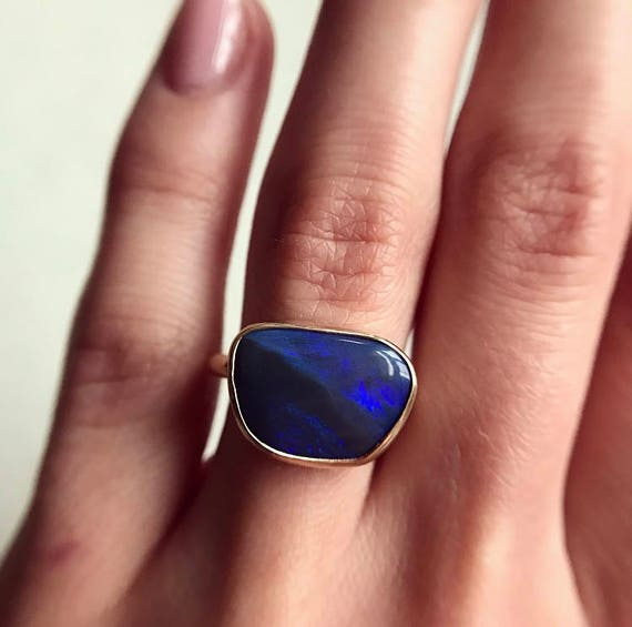 14K yellow gold ring with  black opal SZ 6.75