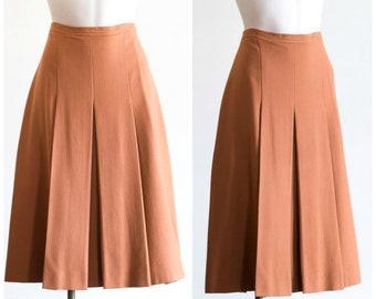 1970s burnt orange pleated skirt