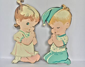 Two Pastel Nursery Wall Plaques of a Boy and a Girl Praying 1960's
