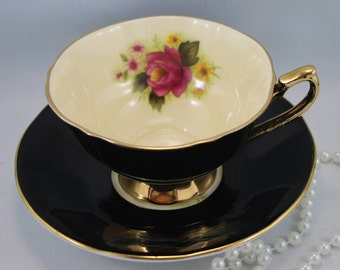 Elizabethan Teacup & Saucer, Red Rose on Pastel Peach Background,Black Borders,Bone English China made in 1970s