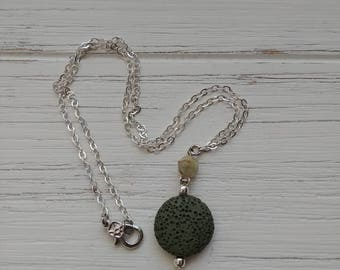 Geometric tourmaline diffuser necklace with green lava rock and brass chain in silver. 20 inch