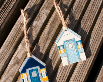 Two wooden beach hut ornaments. Nautical decor.
