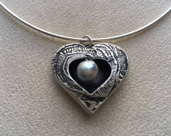 "Sterling silver ""shadow box"" heart with grey pearl."