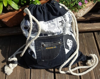 Black jeans with hippie fabric backpack