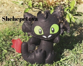 Felt toy Toothless from How to Train Your Dragon