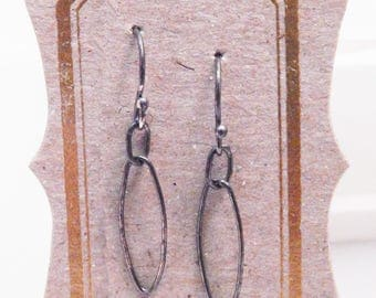 oxidized sterling silver oval link earrings on French ear wires with ball end detailing