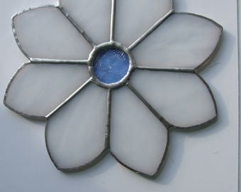 Stained glass sun catcher flower in white and blue.