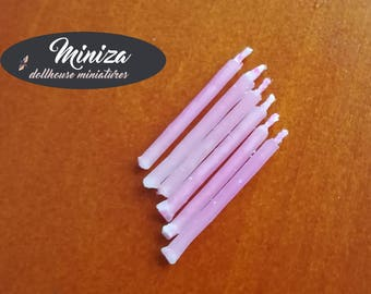 Miniature pink candles, 1:12 scale