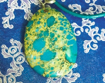 Cabochon of variscite, jewelry on the neck, natural stone, blue, pendant.
