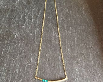 Necklace 14 k with hematite beads and turquoise.