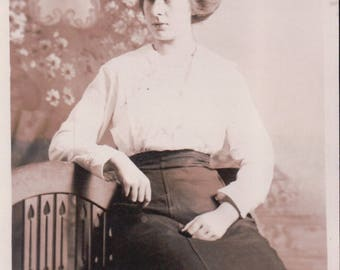Studio Photograph of a Young Woman Sitting on a Bench. - Postcard - Blank - 1913