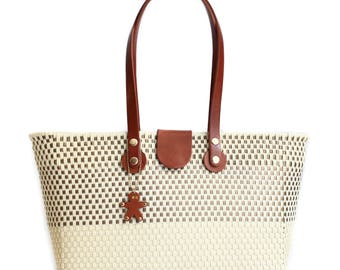 Woven bag with handles in genuine leather