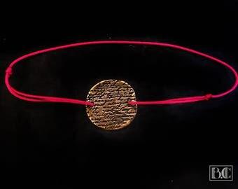 "Pink ""writing"" gilt bronze cord adjustable bracelet"