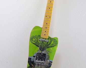 Unique electric guitar custom built from an old school Powell skateboard deck. Great stage guitar!
