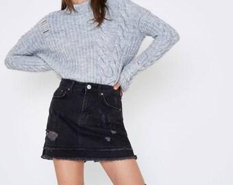 Black distressed denim mini skirt