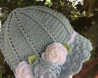 Girl/ woman crochet cloche sun hat with flowers - blue