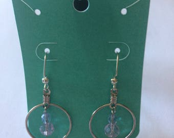 round silver hoods with beads dangling inside