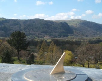 Sundial Topograph.Brass and Slate Sundial shows notable landscape features and locations