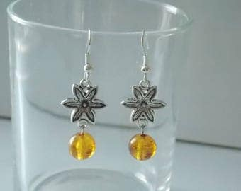 Pair of flower and orange bead earrings