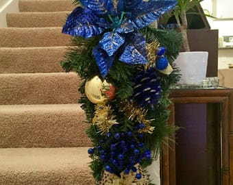 Christmas Swag with Blue decor pine cone and blue and gold accents