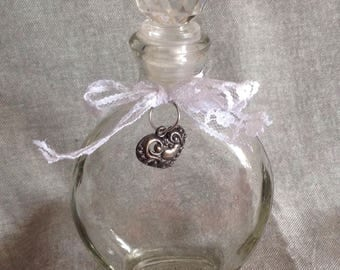 Small bathroom decorated glass bottle