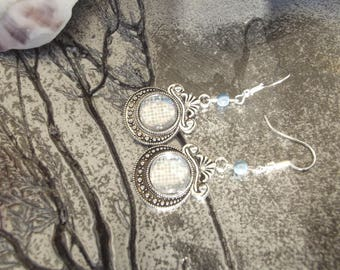 Earrings with silver hooks, beads blue magic effect and silver glitter cabochons.